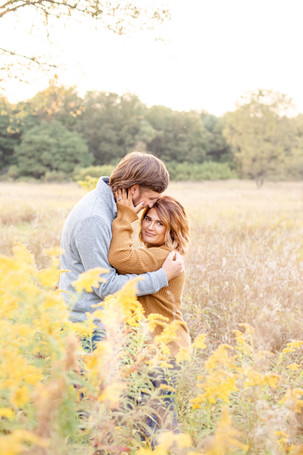 Engagement Photos Al Sabo Land Preserve Kalamazoo Michigan Open Field yellow flowers cute couple