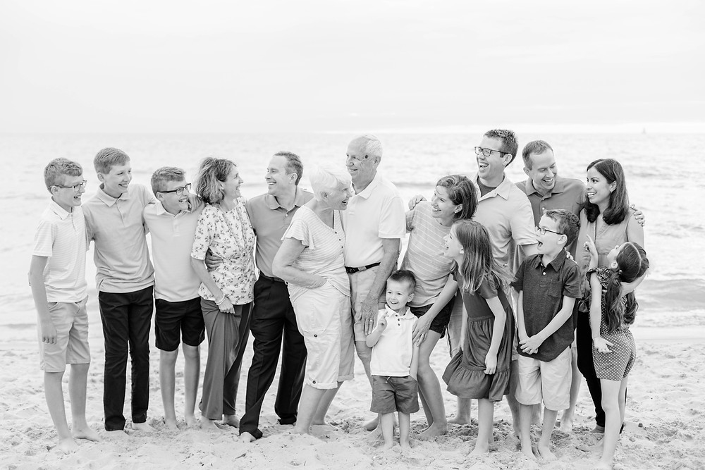 extended family photo shoot laughing on the beach Lake Michigan South Haven Michigan