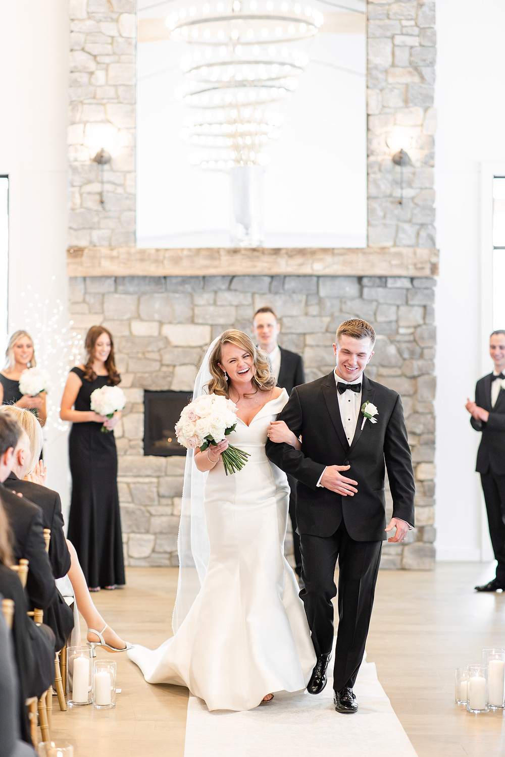 Josh and Andrea wedding photography husband and wife photographer team michigan venue Bay Pointe Woods shelbyville winter wedding ceremony bride and groom walking down aisle