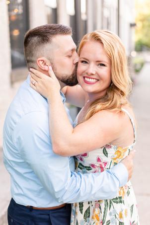 engagement photos couple kissing journeyman distillery weddings three oaks michigan