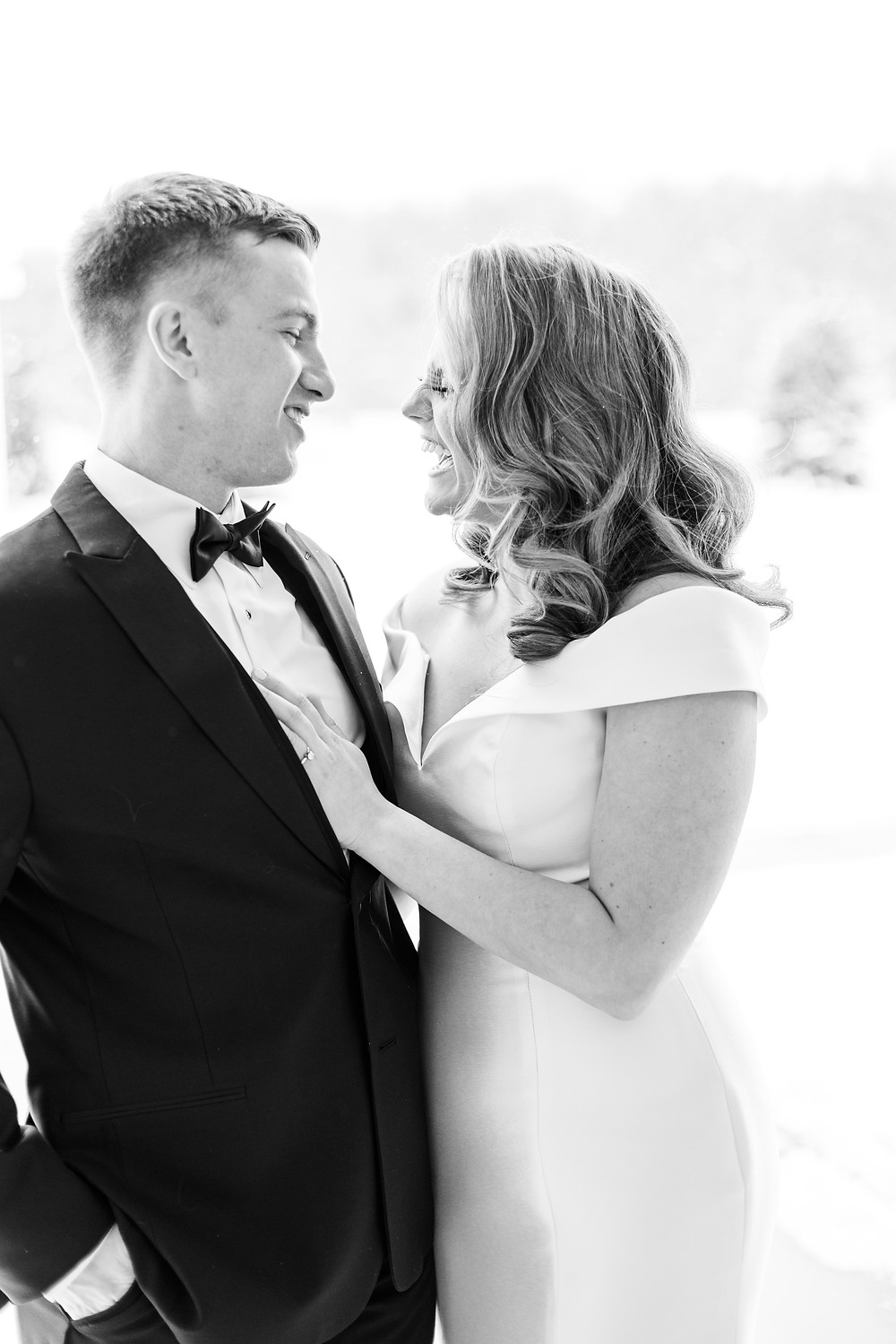 Josh and Andrea wedding photography husband and wife photographer team michigan venue Bay Pointe Woods shelbyville winter wedding bride and groom first look