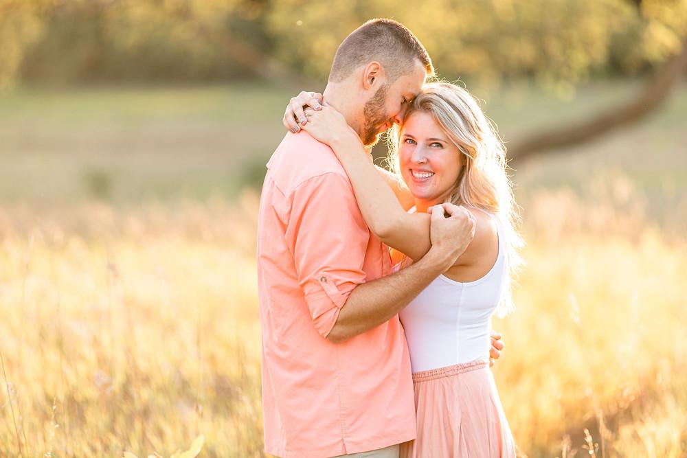 Engagement Photos Al Sabo Land Preserve Kalamazoo Michigan Open Field cute couple hugging