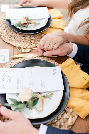 bride and groom eating reception in the details byron center truer design