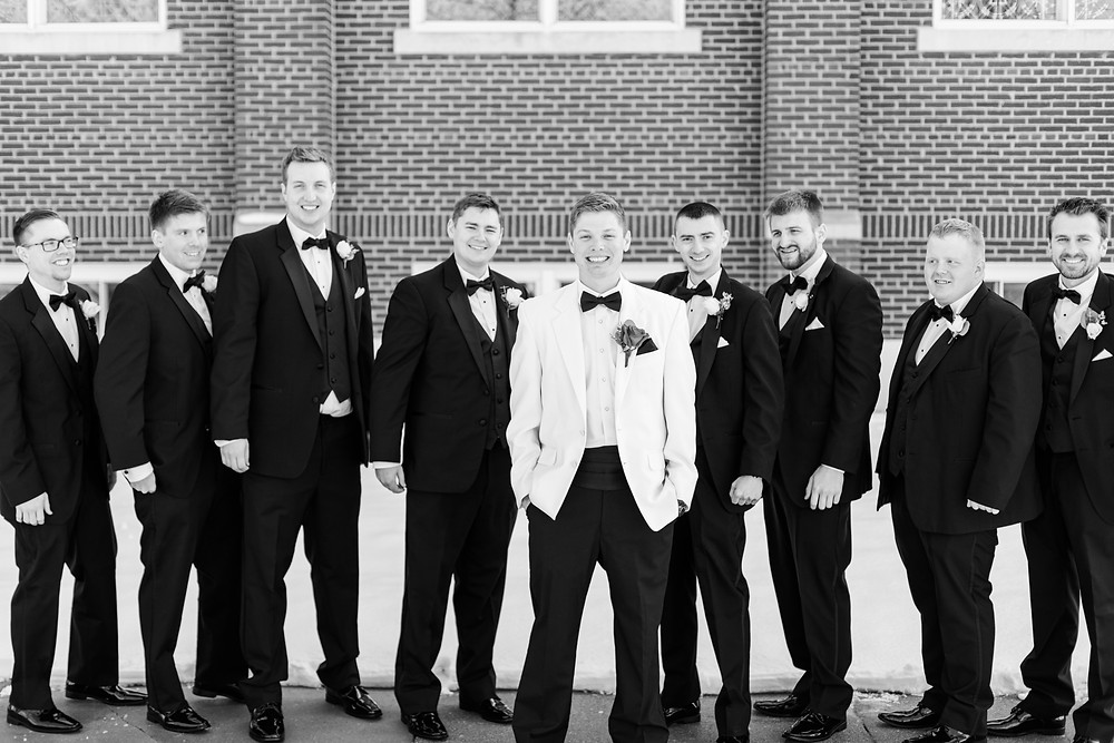 josh and Andrea photography husband and wife team michigan winter wedding south haven st basils groom with groomsmen