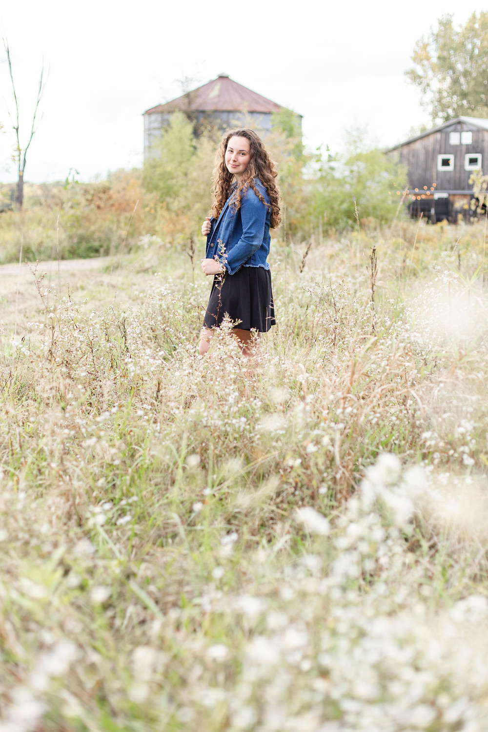 Josh and Andrea wedding photography husband and wife team michigan senior photo shoot session something blue berry wedding barn girl walking in field