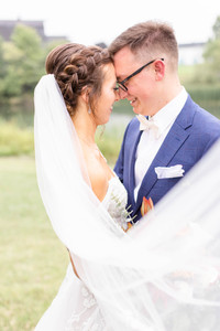 Bride and Groom forehead to forehead Saint Patricks Park South Bend Indiana long veil