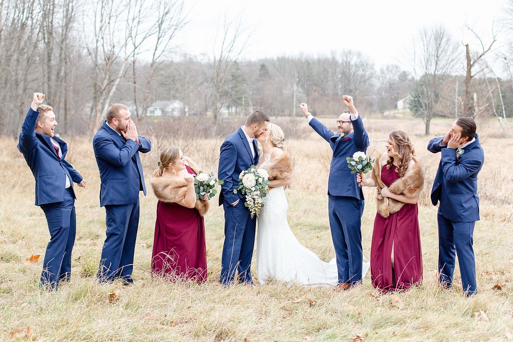 josh and Andrea photography husband and wife team michigan winter wedding bride and groom bridal party