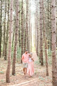 Engagement Photos Al Sabo Land Preserve Kalamazoo Michigan cute couple walking in Tall Pines
