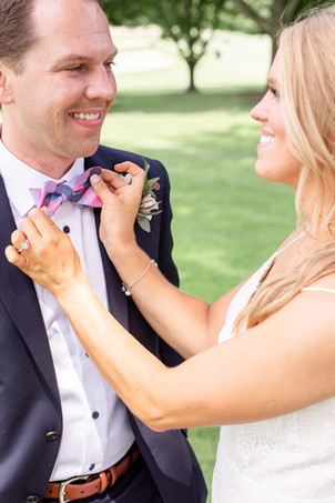 bride and groom fixing bowtie Kent Country Club Wedding Grand Rapids