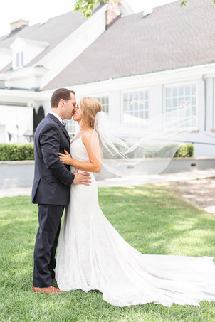 bride and groom veil flying kissing Kent Country Club Wedding Grand Rapids