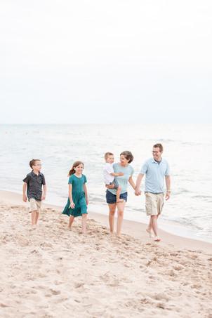 family of 5 walking on beach Lake Michigan South Haven Michigan