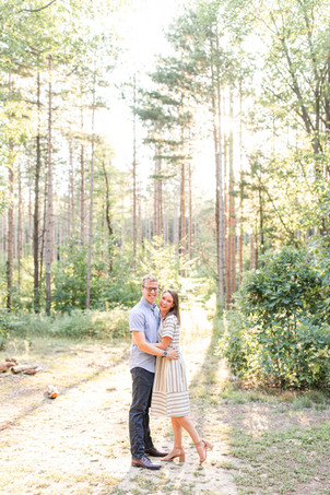 Engagement Photos Riley Trails Holland Michigan Engaged Couple tall pine trees