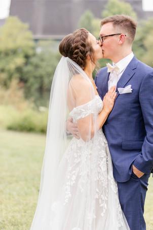 Bride and Groom kissing Saint Patricks Park South Bend Indiana