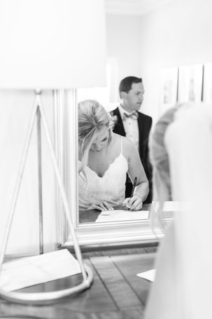 bride signing marriage contract Kent Country Club Wedding Grand Rapids