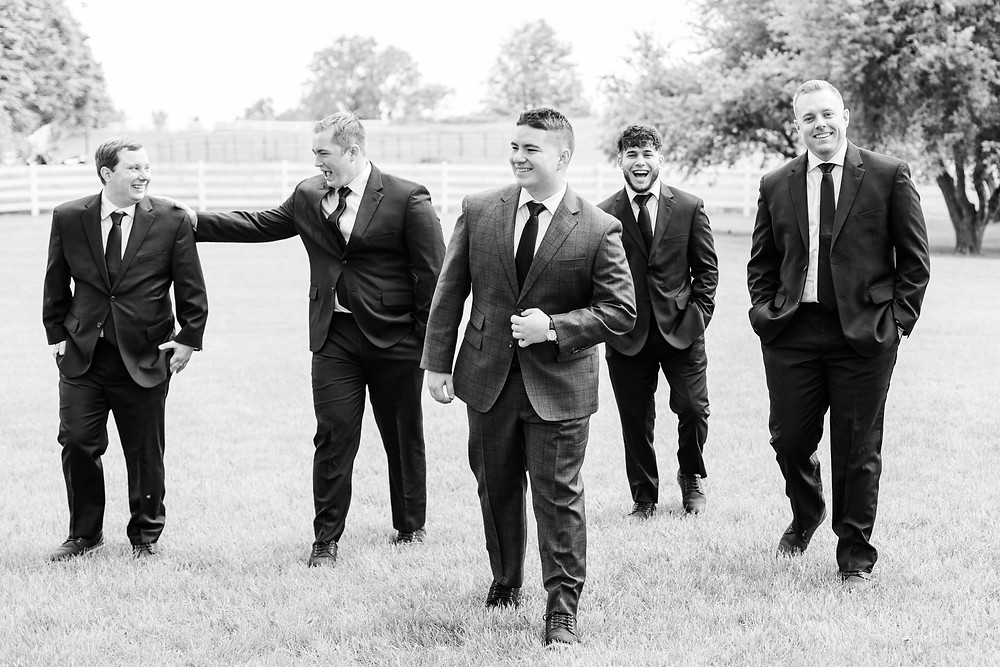 Josh and Andrea wedding photography husband and wife photographer team michigan pictures winter wedding hydrangea blu barn groom apple orchard bridal party groomsmen