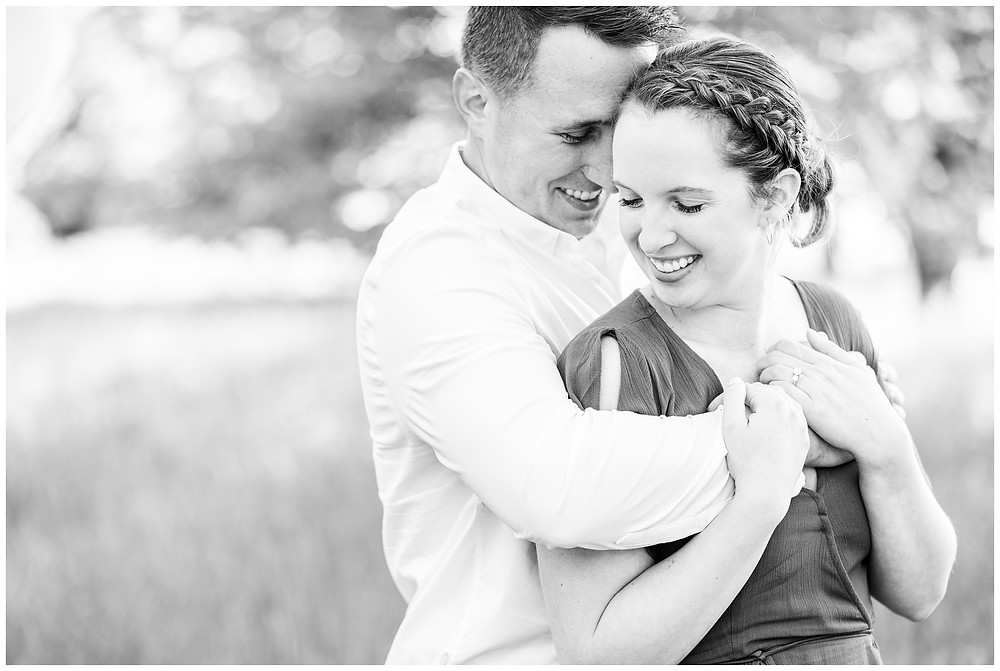 Josh and Andrea wedding photography husband and wife photographer team michigan pictures south haven engagement pictures session fields and woods photo shoot fiance nuzzle