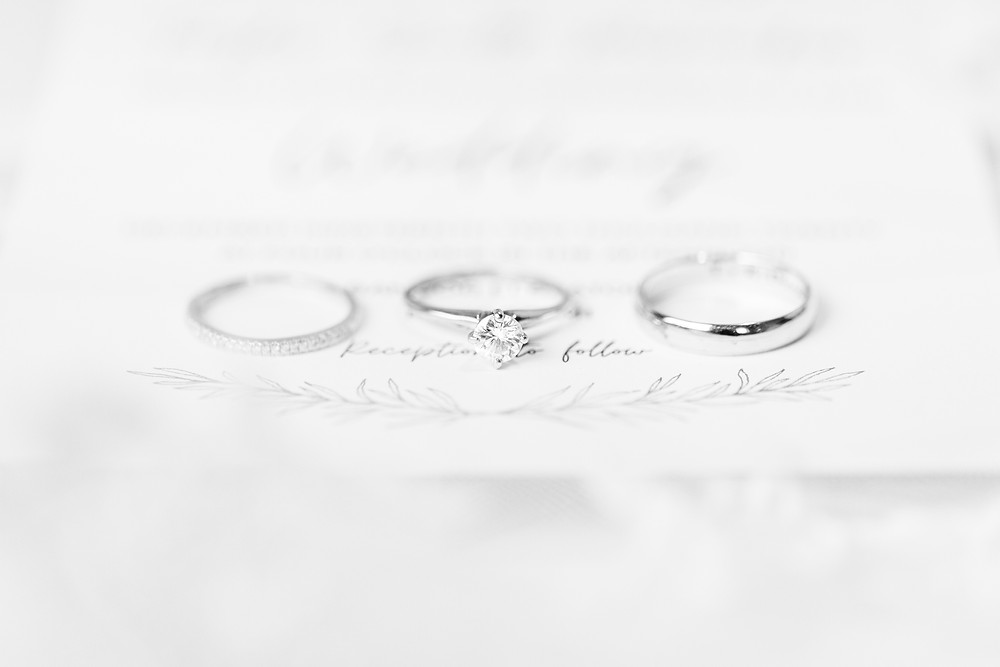 josh and Andrea photography husband and wife team michigan winter wedding ring shot