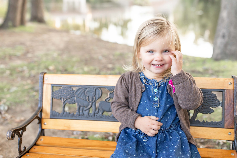 josh and Andrea photography husband and wife team cute family niles michigan daughter little girl sitting on bench