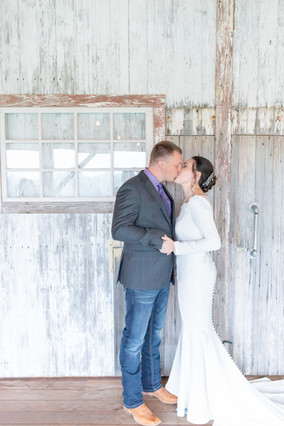 bride and groom hidden vineyard wedding barn Justin Alexander kissing