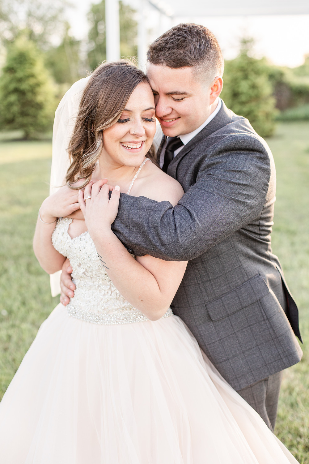 Josh and Andrea wedding photography husband and wife photographer team michigan pictures hydrangea blu barn bride and groom sunset smiling laughing