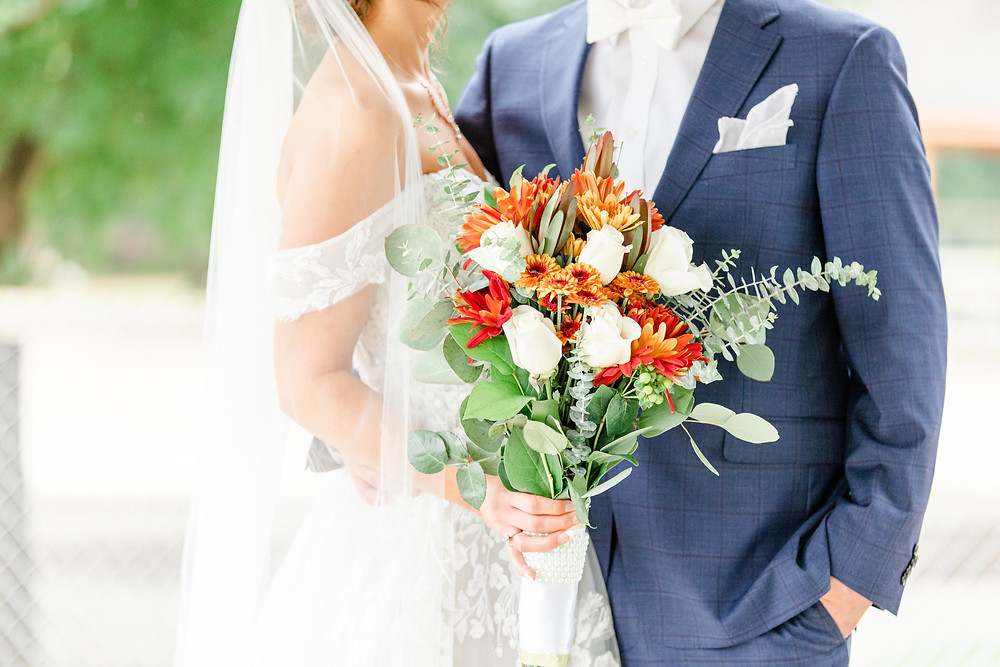 Bride and Groom Bridal bouquet fall colors Saint Patricks Park South Bend Indiana