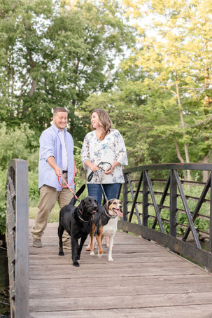 engagement photos couple walking dogs milham park kalamazoo michigan
