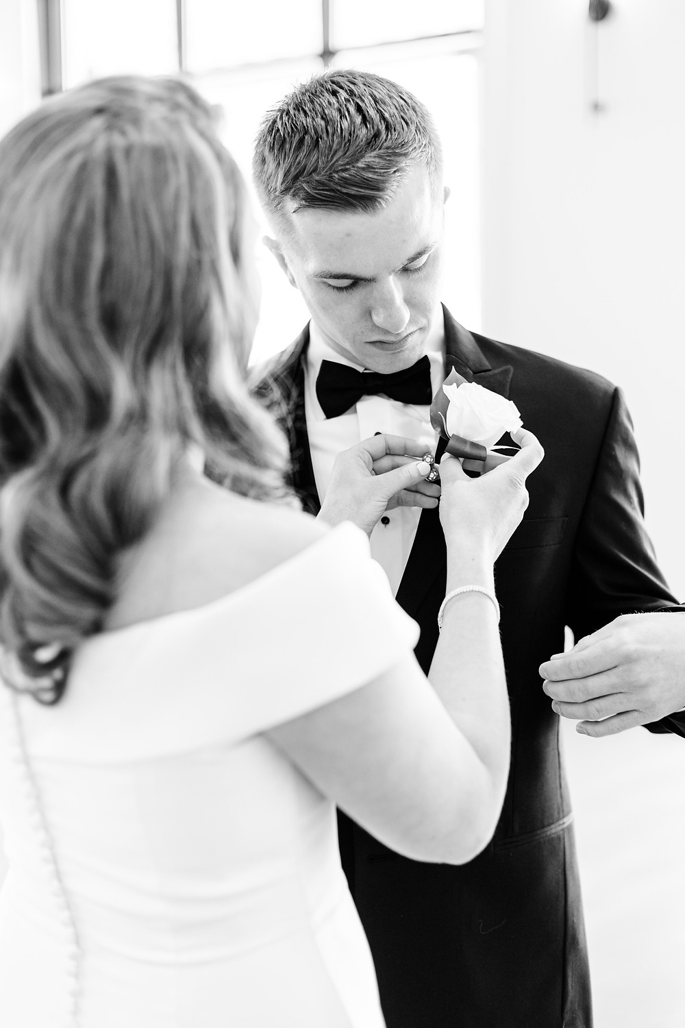 Josh and Andrea wedding photography husband and wife photographer team michigan venue Bay Pointe Woods shelbyville winter wedding bride and groom getting ready first look