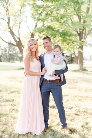 South Haven Michigan Cute Family Photo Session little girl mom and Dad standing smiling in a field