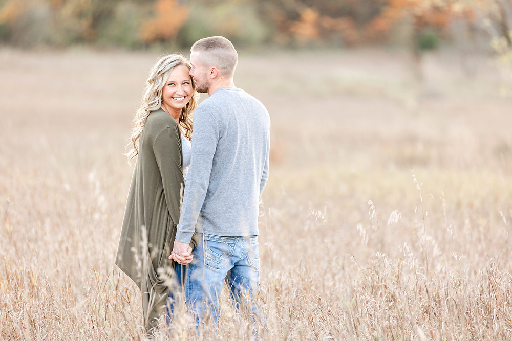 Josh and Andrea Photography engagement shoot Al Sabo cute couple smiling standing in field