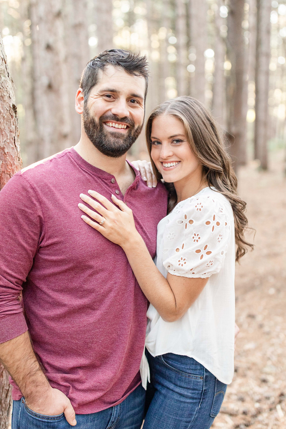 Cute couple standing smiling woods provin trails Grand Rapids engagement session