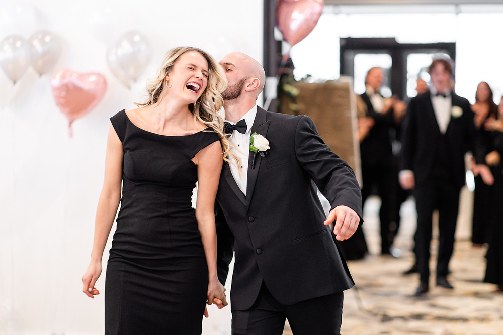 Josh and Andrea wedding photography husband and wife photographer team michigan venue Bay Pointe Woods shelbyville snow winter wedding bridesmaid groomsmen black dress suit