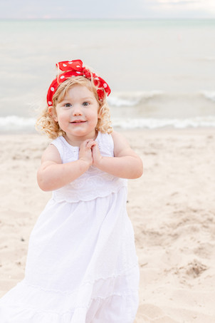 South Haven Family Shoot Cute little girl on the beach Lake Michigan