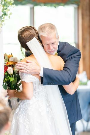 father hugging daughter bride Brown Barn Saint Patricks Park South Bend Indiana