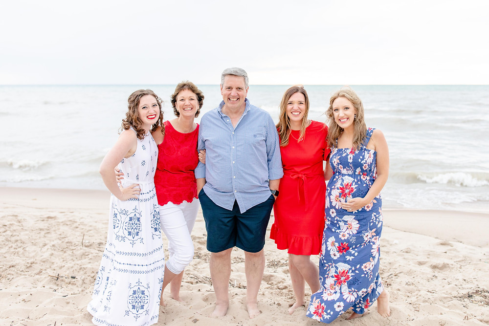 mom and dad and adult daughters on the beach Lake Michigan south haven family shoot red white and blue outfits