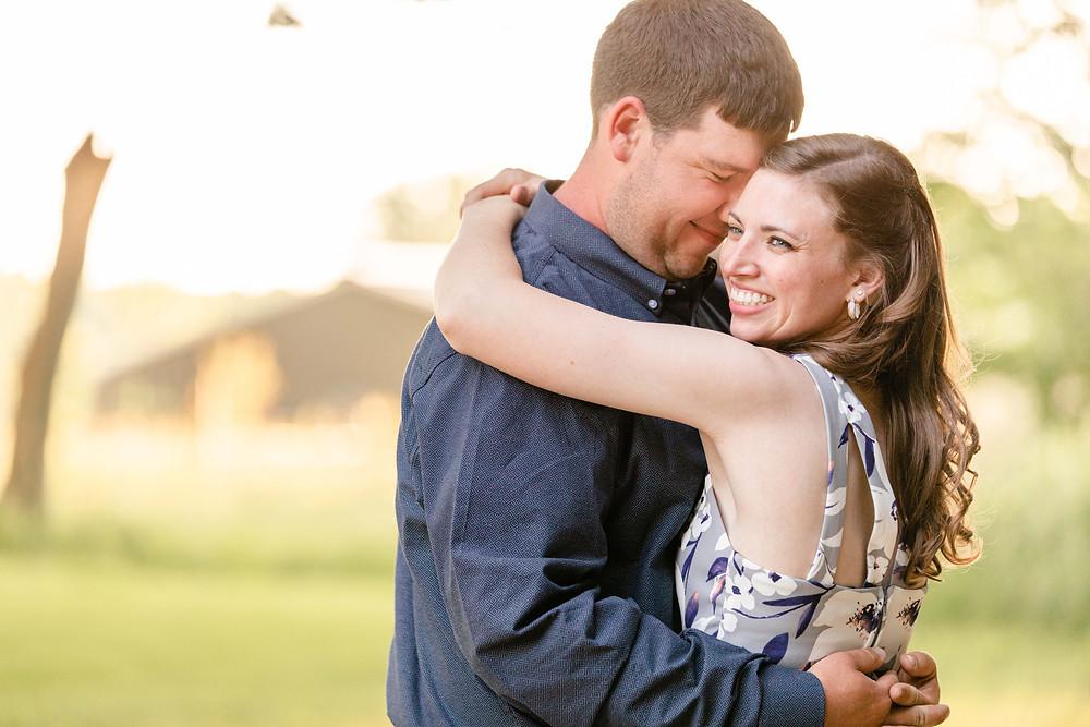 engaged couple standing hugging Something Blue Berry Farm Wedding Venue