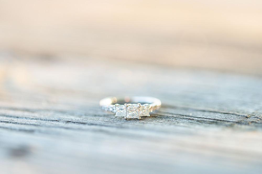 engagement ring on wood Something Blue Berry Farm Wedding Venue