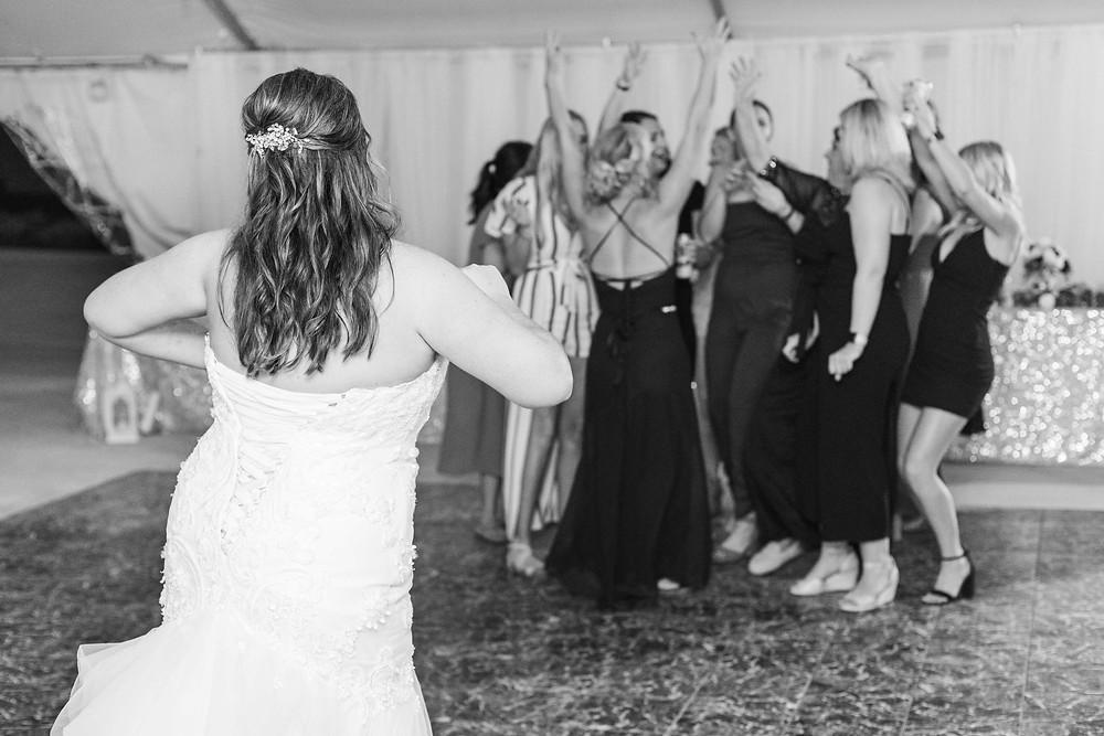 Bride bouquet toss wedding American 1 event center Jackson michigan