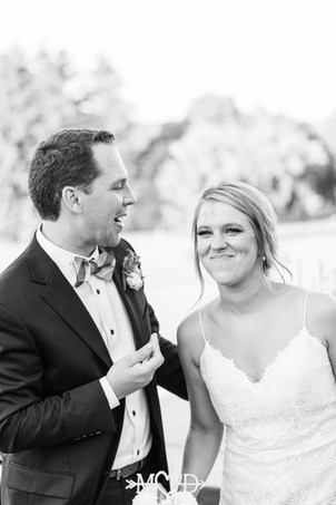 bride and groom eating cake reception Kent Country Club Wedding Grand Rapids
