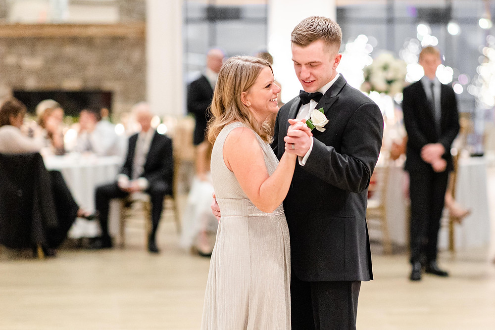 Josh and Andrea wedding photography husband and wife photographer team michigan venue Bay Pointe Woods shelbyville snow winter wedding reception groom mother son dance