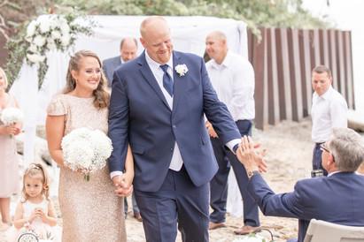 bride and groom walking down aisle south haven beach wedding