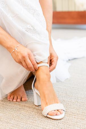 bride putting on heels Kent Country Club Wedding Grand Rapids