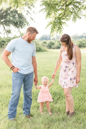 cute family standing in grass