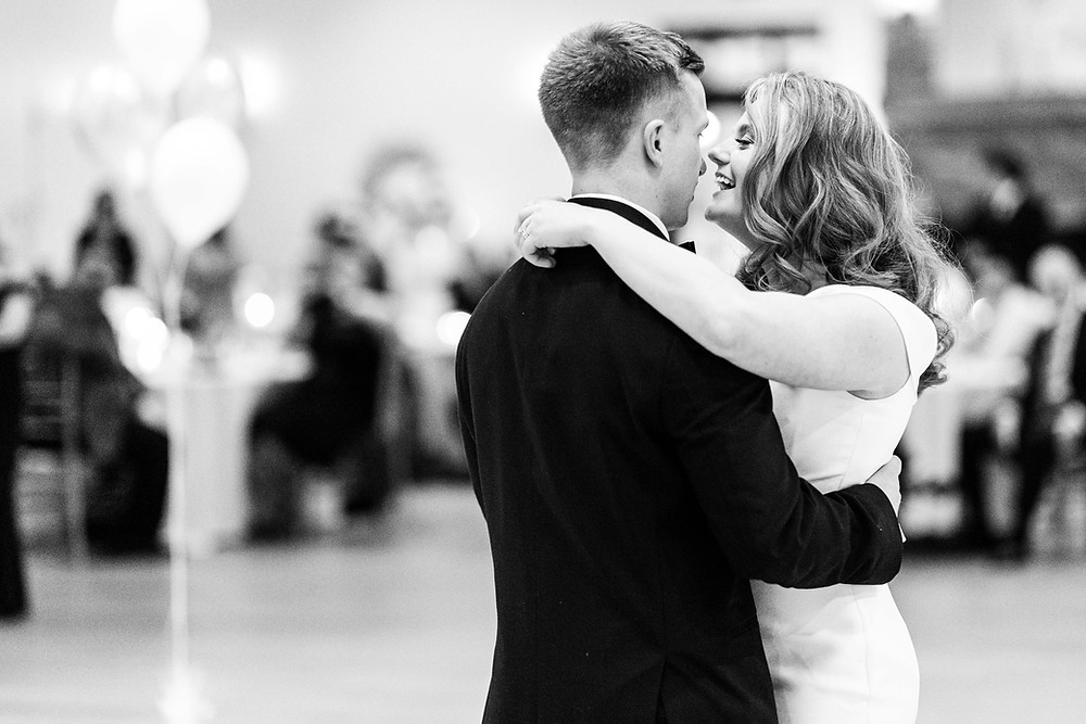 Josh and Andrea wedding photography husband and wife photographer team michigan venue Bay Pointe Woods shelbyville snow winter wedding reception bride and groom first dance