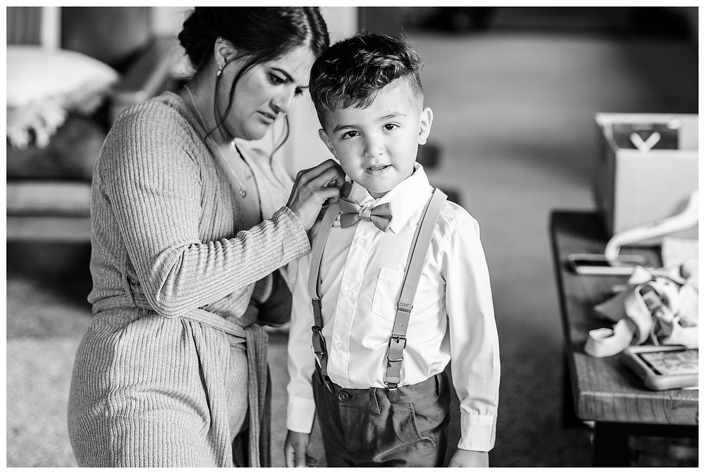 Josh and Andrea wedding photography husband and wife photographer team michigan pictures photo shoot farm barn spring bride and groom farm barn ring bearer