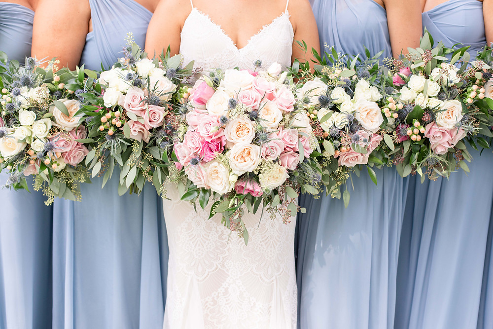 bride and bridesmaids bouquets Kent Country Club Wedding Grand Rapids