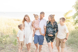 cute family standing smiling on beach south haven