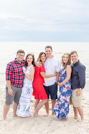 South Haven Family Shoot 3 adult sisters and spouses on the beach Lake Michigan Red White and Blue Outfits