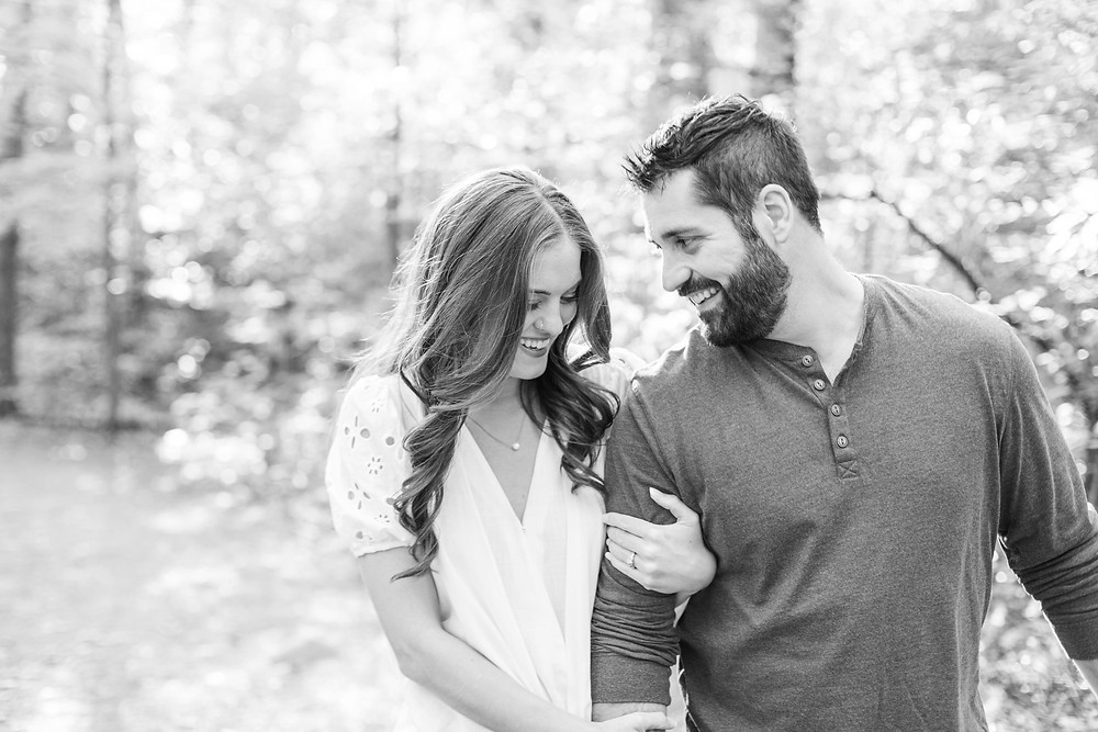 Cute couple walking smiling provin trails Grand Rapids engagement session
