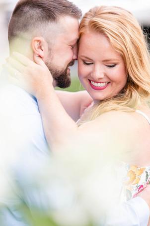 engagement photos couple snuggling journeyman distillery weddings three oaks michigan