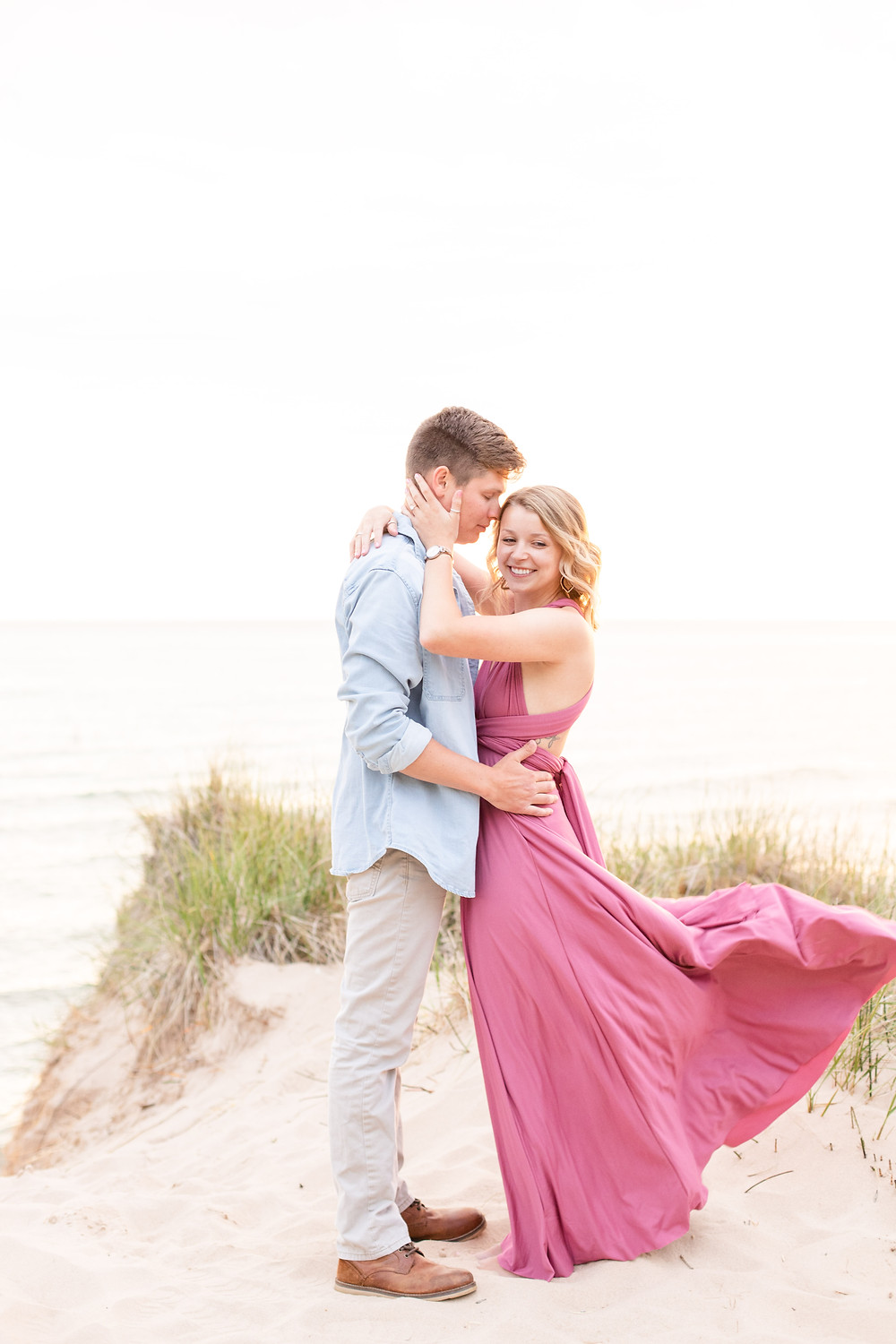 south haven man and women smiling beach engagement photos